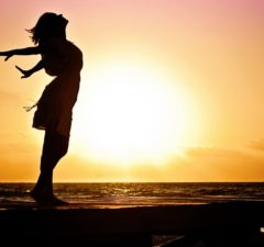 via https://pixabay.com/en/woman-happiness-sunrise-silhouette-570883/